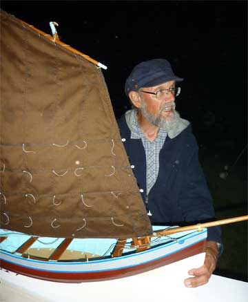 Andrew Kitchen with his model of the Coble