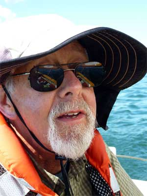 "Nathan Rome at the tiller of ""Bonnie Sea"""