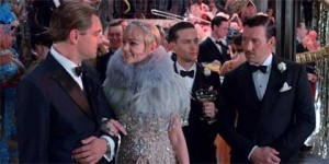 Leonardo DiCaprio as Jay Gatsby, Carey Mulligan as Daisy Buchanan, Tobey Maguire as Nick Carraway, Joel Edgerton as Tom Buchanan in 'The Great Gatsby'