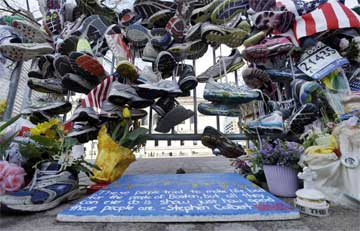 Running shoes hung in makeshift memorial near Boston Marathon finish line, April 2013