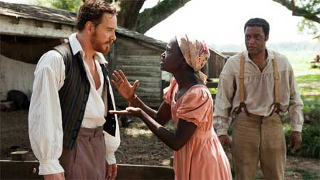 Michael Fassbender as Edwin Epps, Lupita Nyong'o as Patsey, Chiwetel Ejiofor as Solomon Northup in '12 Years a Slave'