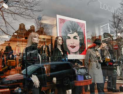 Jackie Onassis poster in store window, photo by Christopher Bullock