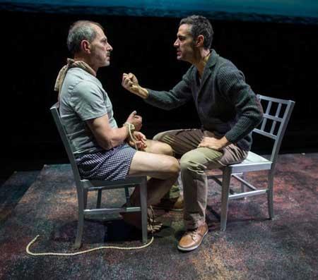 Mark Torres as Roberto Miranda, Mikey Solis as Gerardo Escobar in 'Death and the Maiden'