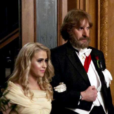 Maria Bakalova as Tutar Sagdivey, Sacha Baron Cohen as Borat Sagdiyev in 'Borat: Subsequent Moviefilm'
